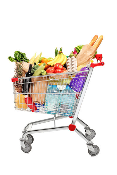 A shopping cart full with groceries isolated on white background